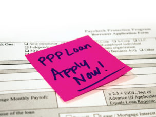 pink sticky note on a loan application reminding reader to apply for PPP Loan