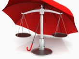 a red umbrella covering a justice scale
