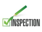 "Check mark on ""Inspection"" illustrated over a white background."